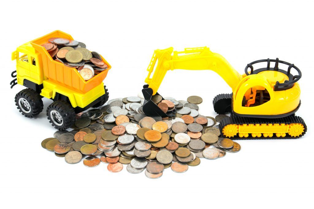 Truck and bulldozer toy loading coins money isolated on white
